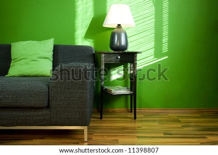 Green room with sofa - stock photo