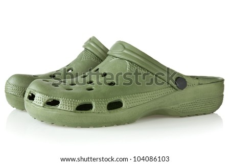 green rubber sandals with reflection on white background