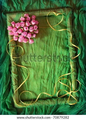 Green rumpled textile frame with yellow ribbon and rose heart