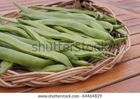 Green runner beans on basket