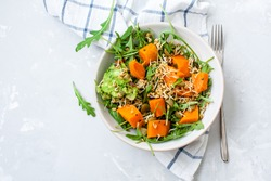 Green salad with sweet potatoes, guacamole and olives. Vegan healthy lunch or dinner. Love for a healthy raw food concept.