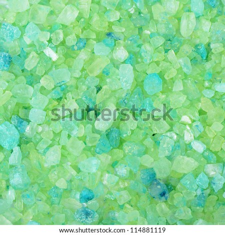Green salt for baths as a background - stock photo