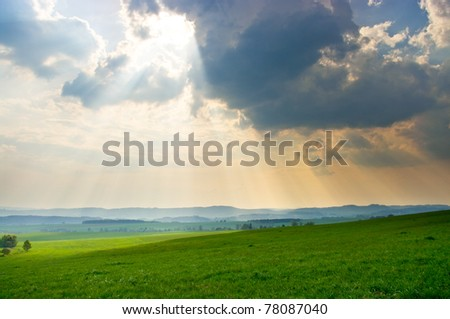 Green scene with dramatic sky