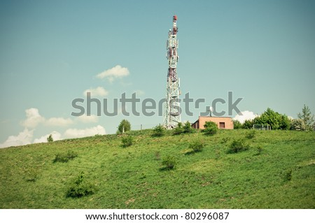 Green scene with transmitter on the hill