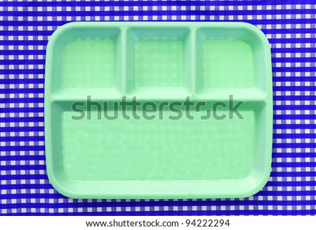 Green School Lunch Serving Tray / Plate isolated on blue and white checkered background