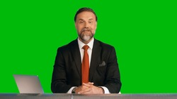 Green Screen Background: Live News Studio with Professional Male Anchor Reporting on the Events of the Day. Television Channel Newsroom Concept. Chroma Key Template Background