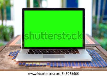 green screen laptop, cup and diary on table #548058505