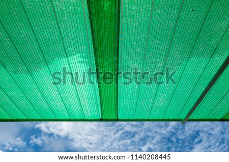 Green shading net roof against with blue sky background #1140208445
