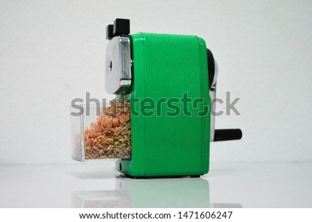 Green sharpener use to sharpen pencil to be sharp