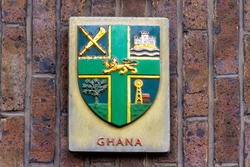 Green shield with golden lion, designed in 1957, it show Ghana's traditional authority, ruling palace Osu Castle, agricultural wealth and abundant natural resources