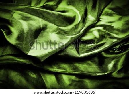Green silk drape, background or texture
