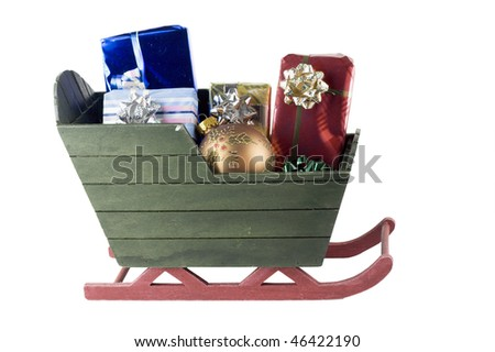 green sleigh with wrapped presents and gold christmas ornament
