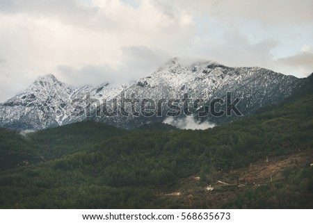 Green slopes of the Taurus mountains covered with snow in winter. Southern Turkey, Alanya, Dim Cay river valley #568635673