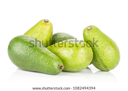 Green smooth avocado stack isolated on white background ripe shiny bacon variety