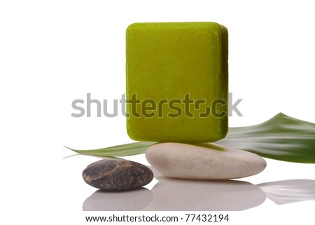 green soap and stone on white with clipping paths