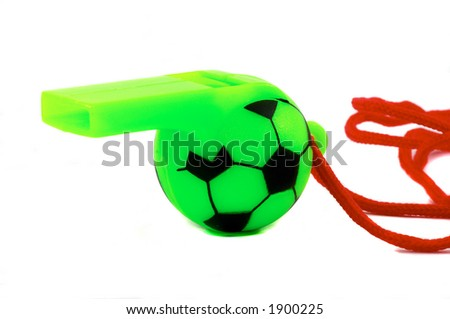 Green Soccer Ball whistle with red string. Mostly the whistle, side view, close up, macro type shot. Isolated on white background.