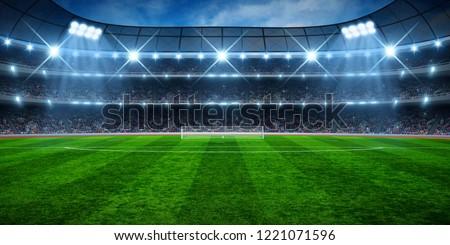 Green soccer stadium, illuminated field, arena in night