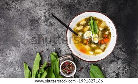 Green Sorrel soup made from broth, sorrel leaves, eggs, Skabenu zupa Latvian soup, top view, Zdjęcia stock ©