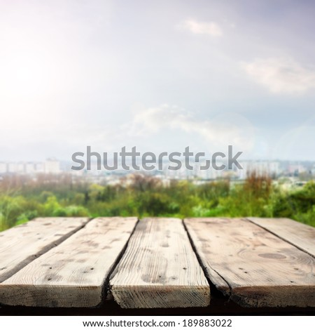 green space city landscape and wooden table