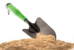 Green Spade in Sand for Gardening