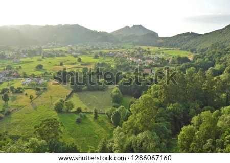 Green Spain - lush pastures with rural dwellings and hills of Cantabria in Northern Spain Europe.