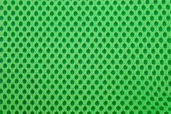green special textile mesh background. Polyester mesh with foam rubber for the manufacture of backpacks. Lining mesh with foam for the inside of a bag or clothes.