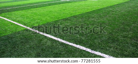 Green sports field with artificial grass