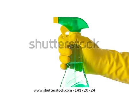 Green spray in hand on white background