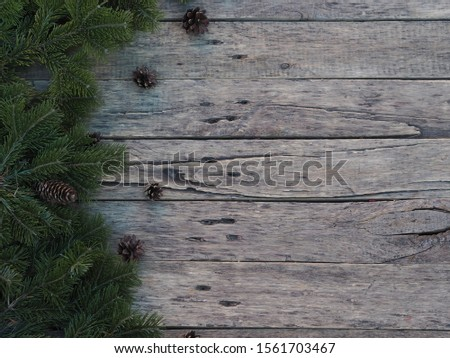 green spruce branches on a wooden rustic rustic ancient table for christmas