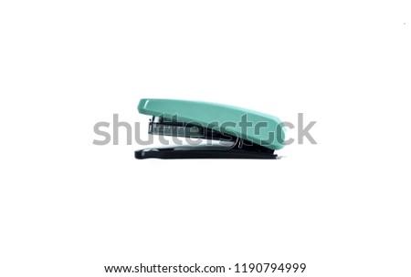 Green stapler isolated on white paper work