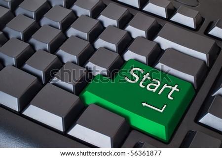 Green start button on Black keyboard