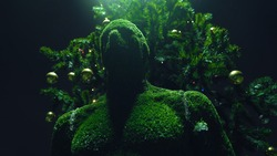 Green statue of abstract man made of artificial grass stands on the street in the evening on the background of a Christmas decorated tree. Green creature sculpture. Garden topiary. Art decoration
