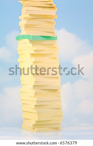 Green Stick Note Pad stacked in Tower of Yellow Ones