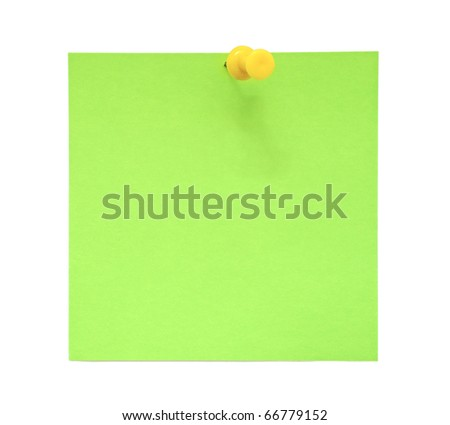 Green sticky note with yellow pushpin
