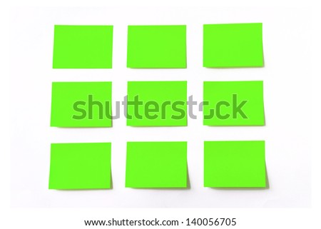 Green sticky notes on white background