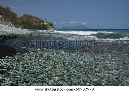 Green stones beach on Flores