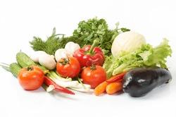 Green-stuff. Fresh vegetables isolated over white background.