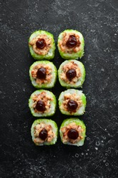 Green Sushi rolls - with eel fish and green Tobiko caviar. Pieces of delicious sushi. Top view.