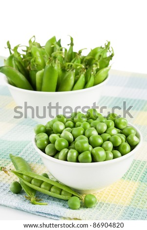 Green sweet organic peas in two bowl