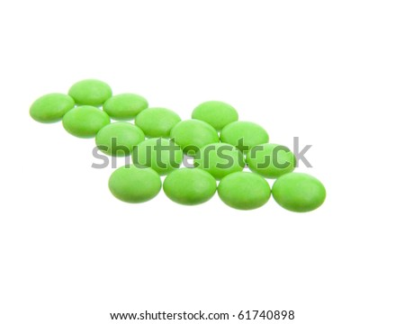 green tablets in arrow formation, isolated on white background