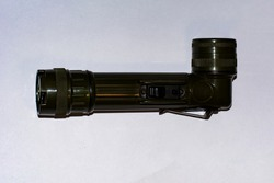 green tactical flashlight with mount