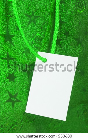 green tag on present - blank for you to write or place a photo