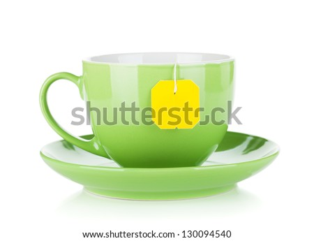 Green tea cup and teabag. Isolated on white background