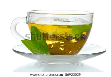green tea in transparent cup and mint isolated on white