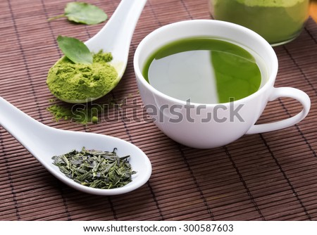 Green tea n the brown mat close-up #300587603