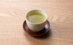 Green tea on a wooden tray. Japanese green tea image