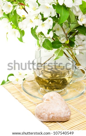 Green tea, white flower with green leaves  and spice-cake