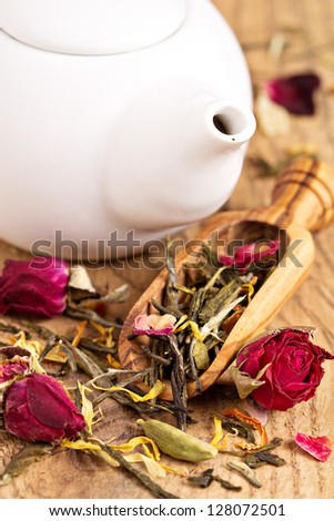 Green tea with fruits, spices, rose petals in a scoop