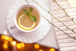 green tea with lemon in a white cup