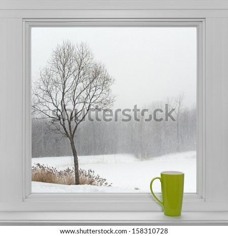 Green Teacup On A Windowsill, With Winter Landscape Seen Through The Window.